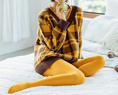 woman with mustard color elastic tights sitting on white bad.